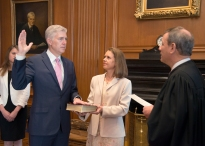 In this photo provided by the Public Information Office Supreme Court of the U.S. Chief Justice John G. Roberts, Jr., administers the Constitutional Oath to the Neil Gorsuch in a private ceremony attended by the Justices of the Supreme Court and members of the Gorsuch family, including wife Louise Gorsuch, Monday, April 10, 2017, in the Justices' Conference Room at the Supreme Court in Washington. Surrounded by family and his soon-to-be Supreme Court colleagues, Gorsuch took the first of two oaths as he prepared to take his seat on the court. (Franz Jantzen/Public Information Office Supreme Court of the U.S. via AP)